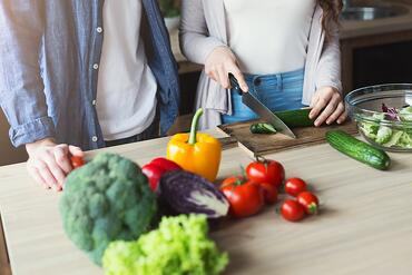 couple-cooking-healthy-food-together-PN7GHCD-min